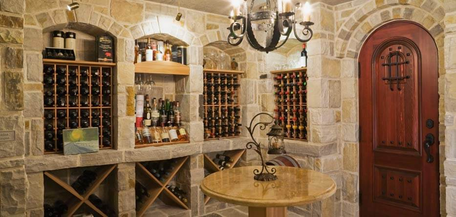 Photograph of a wine cellar with stone walls