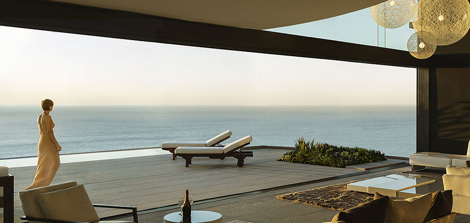 woman walking on the terrace of her luxury waterfront home